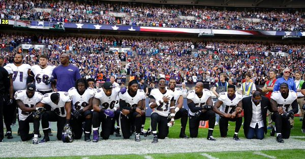 NFL players refuse to stand up for US national anthem, but